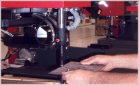 A hydraulic fastener machine frees other equipment for greater productivity